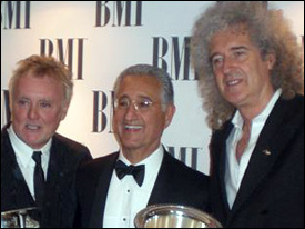 Queen's Roger Taylor and Brian May with Del Bryant