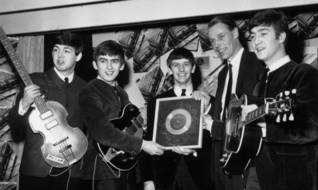 George Martin and The Beatles in 1963